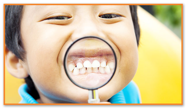 Kid with magnifying glass - Montclair Pediatric Dental Near Clifton