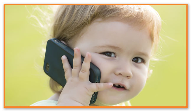 Toddler on cellphone at Montclair Pediatric Dental Care Near Verona