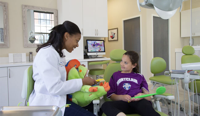Doctor with Patient at Montclair Pediatric Dental Care Serving Verona, Clifton, Bloomfield, West Orange and Glen Ridge